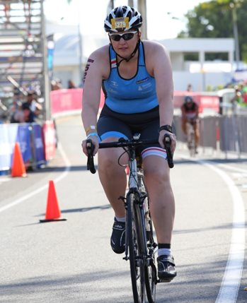 Jen rides her cycling road bike in the Smiling for Smiddy triathlon.